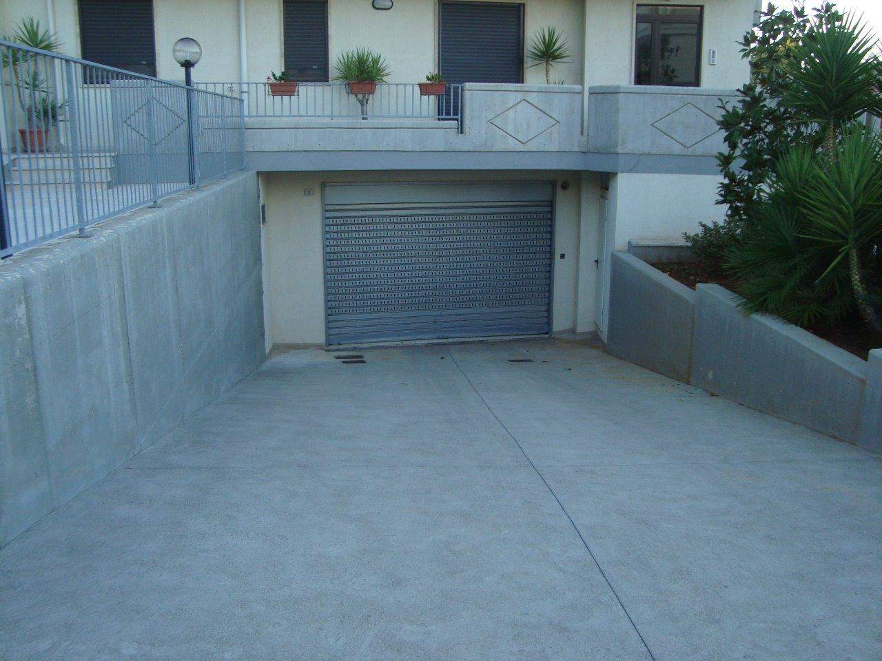 Four Garages of diverse dimensions