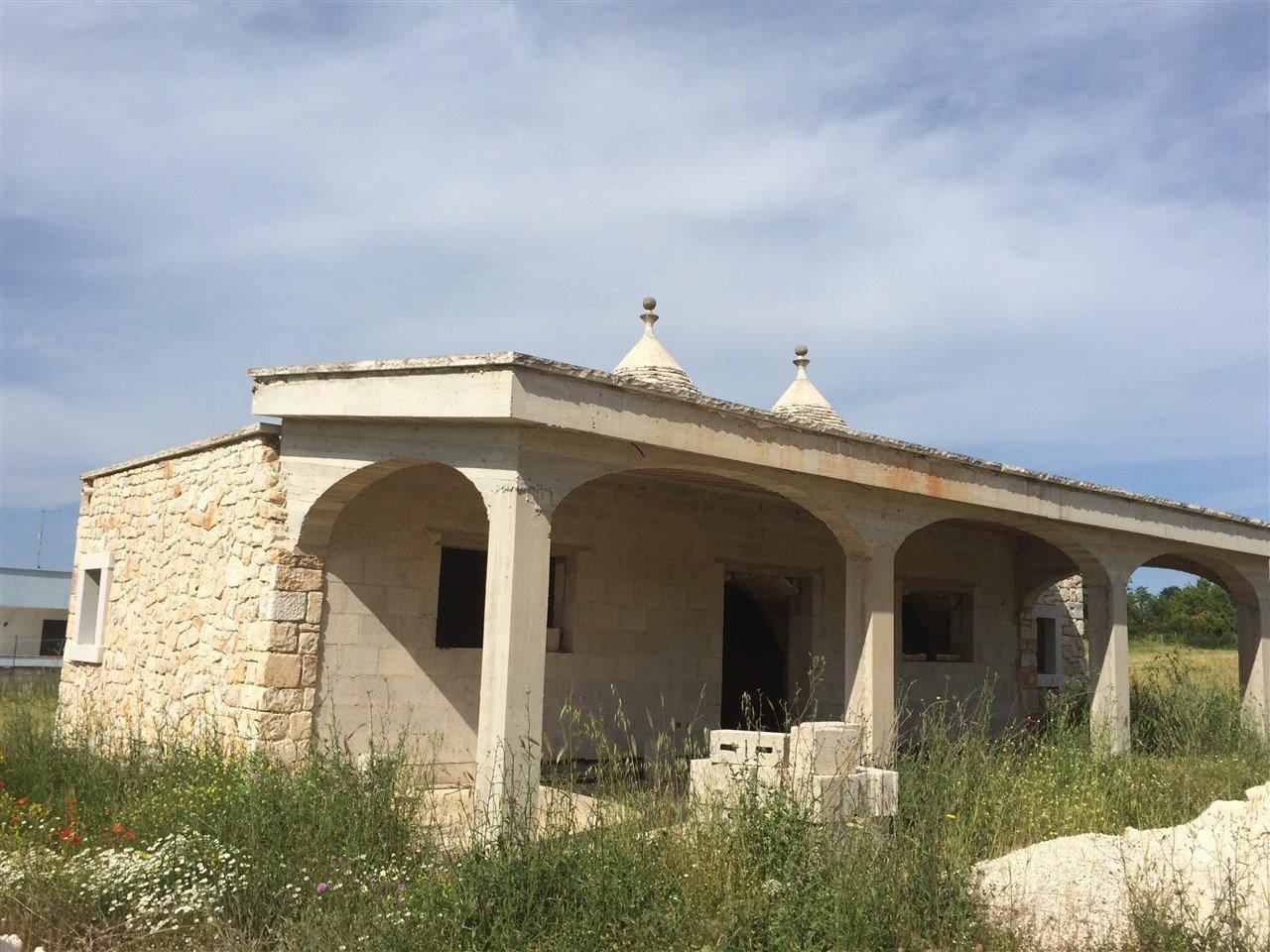 House with trulli and veranda, partially restored